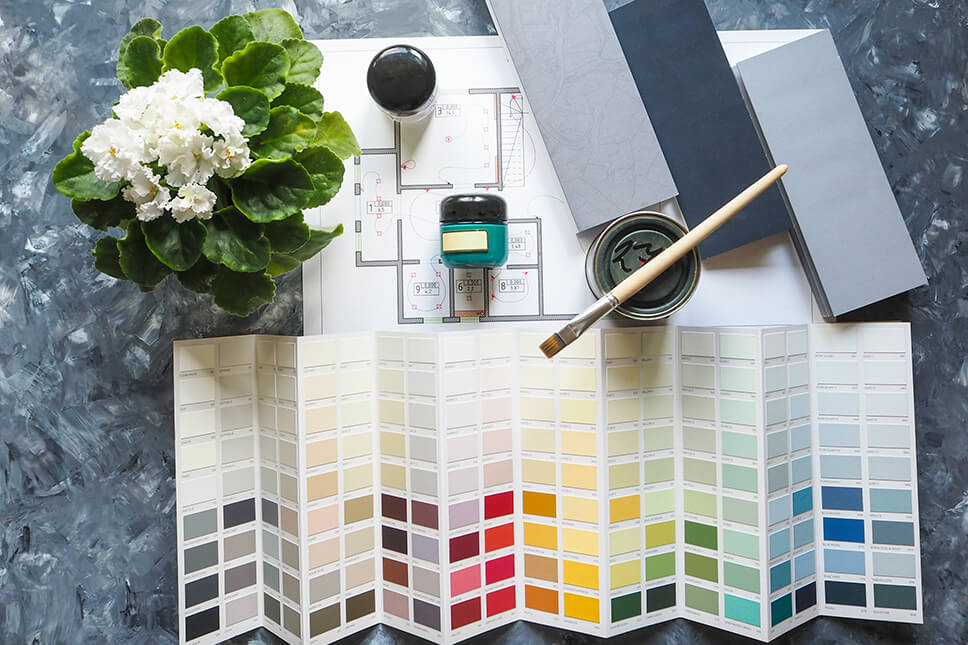 Photo of paint samples and blueprint for How To Customize Your Home Blog